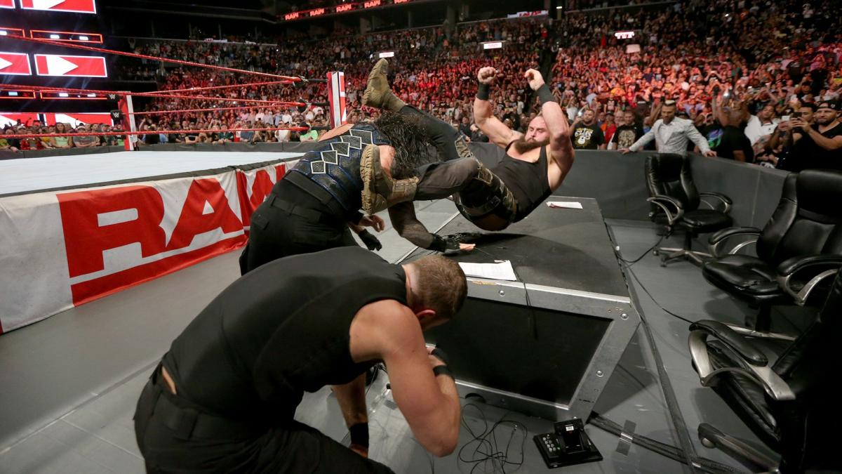 The Shield Triple Powerbomb Strowman through the table!