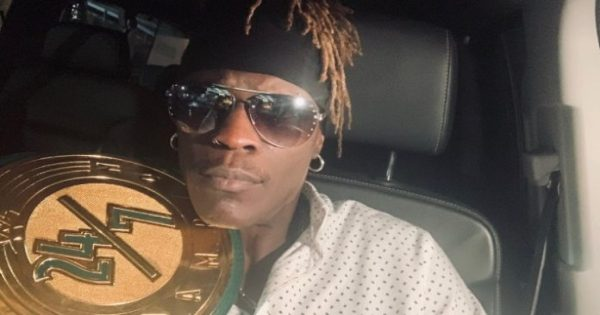 R-Truth with the 24/7 Championship